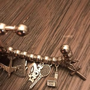 Jewelry - Vintage Sterling Silver bracelet with charms